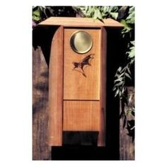 Colony bat house made from sturdy redwood, with a brass moon and bat design.