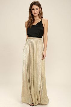 Make everyday a holiday with the Jovial Occasion Gold Maxi Skirt! Shiny metallic gold fabric creates a high, banded waist that descends into a full and eye-catching maxi skirt.