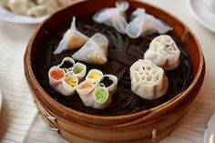 Dumpling Banquet (饺子宴) of different shapes, colors and tastes