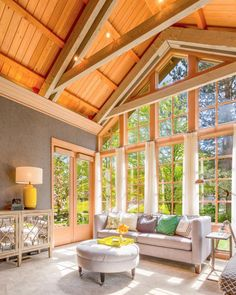 A wall of windows floods this cathedral-like great room with beautiful natural light. The vaulted wood ceiling adds natural warmth to the space and neutral furnishings and carpet keep it feeling open and bright.