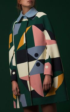 This **Parden's** Yoma Printed Cape features a round collar with a color block…