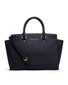 "$360  MICHAEL Michael Kors Large Selma Top-Zip Satchel    Navy saffiano leather.  Tote handles.  Top zip.  Logo at top front.  Adjustable shoulder strap.  Inside, monogram lining; one zip and four open pockets.  9""H x 12 1/4""W x 3 1/2""D."
