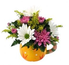 From The Sunny Seasons Collection, this beautiful floral arrangement was designed by The Flower Shop at Stauffers of Kissel Hill. For more information visit http://www.skh.com.