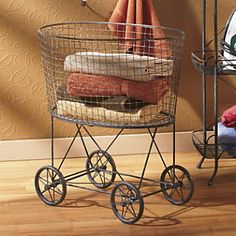 Here's a rolling laundry basket that looks vintage farmhouse and holds a mountain of storage possibilities. Distressed painted finish adds a touch of rustic charm. Use it in a craft room, bedroom. Decorate Now, Pay Later with Country Door Credit Rolling Laundry Basket, Wire Laundry Basket, Laundry Cart, Wire Baskets, Laundry Table, Laundry Hamper, Decorative Accessories, Home Accessories, Laundry In Bathroom