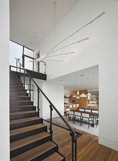 A custom sculptural light fixture can be viewed from various points in the foyer in this home in San Francisco.