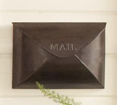 Antique Envelope Mailbox - $49.00»  For the look of copper without the price tag, this mail pouch is available in bronze and antique nickel.