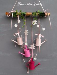 Window hanger with small watering cans . Four small watering cans, plus white ., Window hanger with small watering cans . Four small watering cans, plus white wood flowers and a little artificial. Small Watering Can, Diy And Crafts, Arts And Crafts, Wood Flowers, Diy Ostern, Spring Crafts, Easter Crafts, Fall Decor, Spring Decorations