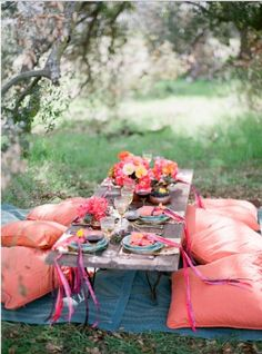 make your own picnic table with 2 stumps on each side and an old board or even better old door for the table top.  Tables can be easily moved/ broken apart for ceremony/reception