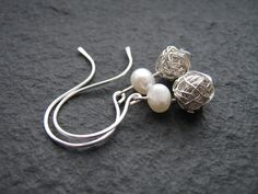 Pearl and silver wire wrapped earrings