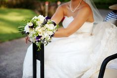 Bridal bouquet featuring white freesia and purple sweat pea