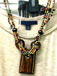Indian Summer necklace with wood and multi-color beads. Adds a nice Boho vibe Cactus Blues Boutique