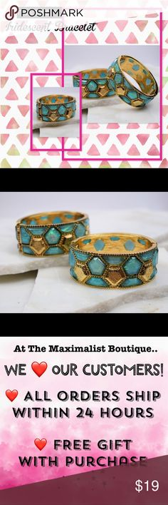 "Fantasy Bangle Bracelet Fulfill your fashion fantasy in our hinged bangle bracelet! Gold plated bracelet features intricate honeycomb design with iridescent green stones.  Approx. 1.1"" width, 7.5"" diameter. The Maximalist Boutique Jewelry Bracelets"