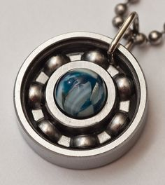 Blue Mother of Pearl Roller Derby Skate Bearing Pendant #rollerderby #bearingjewelry #derbygirldesigns #rollerderbygifts