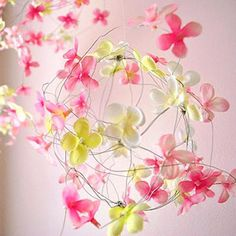 I love this idea for baby girl. Create your own mobile with floral wire, glue and faux blooms. So cute!
