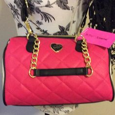 Betsy Johnson medium satchel in fuchsia XOX Betsy! Treat yourself or someone you love to the perfect gift! Charming Betsy Johnson medium size satchel in fuchsia, black and bone. Quilted faux leather with gold hardware,  zipper and black detachable crossbody strap. The black leather handles are on gold chains.  This back really is a charmer. New with tags and from a smoke free and pet free home. Betsey Johnson Bags Satchels
