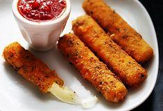 Yummy mozzarella sticks with marinara sauce.