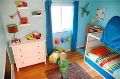 cute toddler boy rooms. love the trucks on the shelves