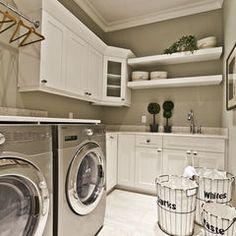 Stainless steel in the laundry?contemporary laundry room by Marcson Homes Ltd.