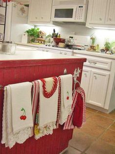 vintage tea towels - love the single red cabinet :)