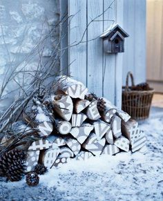 The kids can make nordic designs on snow-dusted firewood for hours.