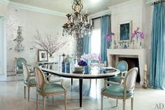Believe it or not, this turquoise and ivory dining room belongs to Ozzie Osborne. I believe Sharon had a hand in the color choice.