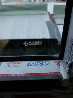 Kính cường lực logo Á Châu Doors & Windows - phụ kiện cửa nhôm Xingfa chính hãng