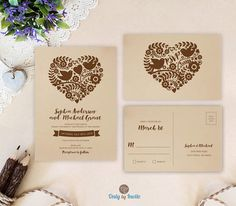 Kraft wedding invitation sets featuring floral heart. Love bird wedding invitations printed on brown kraft paper. Affordable wedding invitations