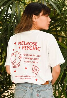 """This relaxed T-shirt features a silk-screen print with the text """"Present Past Future"""" on the front & Melrose Psychic designs on back."""