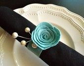 for napkins on reception table.i like the little pearls peak out..could use pearls with tulle napkin bows
