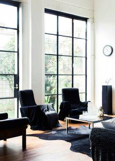 black framed windows. Melbourne Home Georgie and Alex Cleary of Alpha60 via The Design Files
