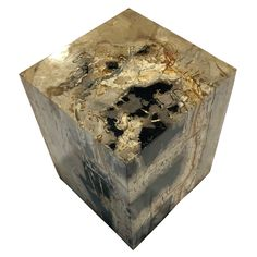 """POLISHED SQUARE PETRIFIED WOOD STOOL Dimensions 14"""" (W) x 14"""" (D) x 18"""" (H) Polished Square Petrified Wood Stool Matching set available, Item #085 Petrified Wood Side Table offered by Organic Findings. Our Petrified Wood Tables are part of a large collection of unique objects. We combine contemporary design ideas with global product sourcing. Organic Findings sources the highest quality petrified wood, please visit our online store."""