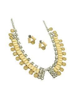 Debutant, we all know you've hidden a flask under that giant dress.   Debutant is a Shourouk and vintage inspired rhintestone collar that sits high, like you.  Peach colored stones and clear paste rhinestones make this collar necklace a sparkly mess of a thing.  Necklace is 18 inches long a...
