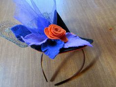 How to make a tiny wearable witch hat with felt flowers. Just in time for Halloween!