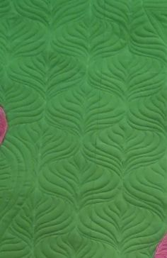 Wrote a tutorial on my blog how to quilt this background  fill.  Works for domestic or longarm machines.
