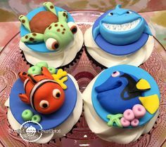 Finding Nemo and Dory cupcake toppers  http://www.sweetfondanttoppers.com/