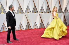 Oh Mann! Leslie poses in her Zac Posen dress as her husband of 20 years, Judd Apatow, look...