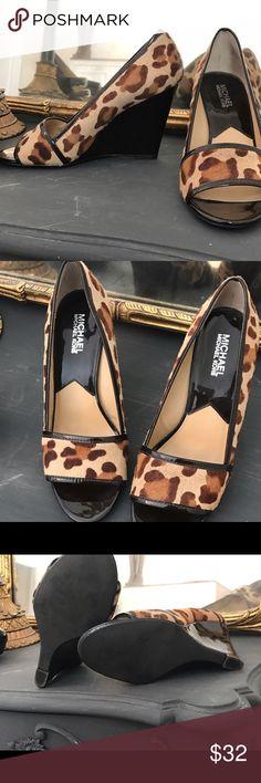 Michael Kors calf hair leopard print wedge Beautiful neutral tone Michael for Michael Kors wedge heels.  Worn once size 8 MICHAEL Michael Kors Shoes Wedges