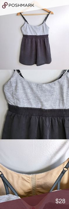 Lululemon Babydoll Tank Gray and white striped top, baby doll flowy dark grey bottom, spaghetti strap adjustable, cute for working out or running around town. Good condition. 15 across the chest. Elastic band 14 inches. lululemon athletica Tops Tank Tops
