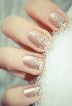 Brides.com: 15 Sparkly Manicures to Rock with Your Engagement Ring A nude manicure with a faded sparkle effect.Photo: Brit + Co via Pinterest