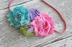 Pink, aqua, lime and lavender chiffon flower and rosette headband. Birdie Baby Boutique.