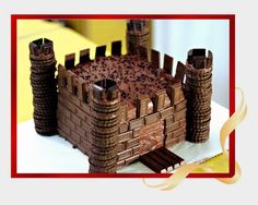 Chocolate Divine Castle: 2kg cake made of devils Food Cake Soaked in Sugar Syrup Sandwiched with Chocolate Fresh Cream Icing and Chocolate Truffle. ~ finish up with chocolate round cookies towers - bricks of mini Hershey squares, kit-kat bars ramp