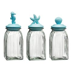 Global Amici Coastal Bright 3-Piece Square Canister Set at Wayfair Bright, coastal storage canisters with icons of a seahorse, starfish and clam.