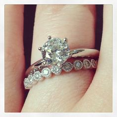 ooh I love the simple engagement ring and the unique wedding band