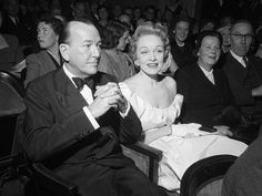 Marlene Dietrich Sitting in the Stalls of the Globe Theatre with Noel Coward Photographic Print