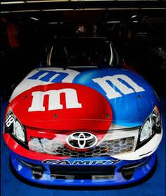 The #18 M's Red, White & Blue Toyota finished # 3 in the 2012 Coca Cola 600, driven by Kyle Busch. Car sits in the garage during practice for the NASCAR Sprint Cup Series Coca-Cola 600 at Charlotte Motor Speedway on May 24, 2012 in Concord, North Carolina.