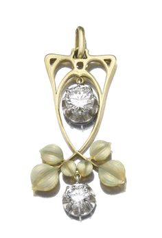 ENAMEL AND DIAMOND PENDANT. Designed as stylised leaves decorated with light green enamel, suspending two circular-cut diamonds weighing 1.30 and 2.39 carats respectively, to a fine chain, length approximately 550mm. Art Nouveau or Art Nouveau style