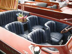 Evangeline. Hacker. The wrap-around channel backs and four individual bucket seating arrangement is unique to this boat.