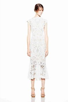 """Alexander McQueen  Love how edgy this feminine dress is .. how unique would this be if used as a wedding dress? Oh wait, I think I just found my """"white"""" dress for Sean's party this year!! (Combs that is.) :)"""