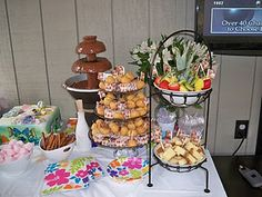 The chocolate fondue table included pound cake, fruit, donut holes, marshmallows, pretzels.-- Love the donut idea