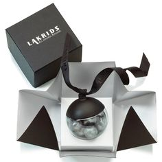 Lakrids by Johan Bülow's . 2016 seasonal confectionery delights in Silver. Dressed to impress,silver flavour is dark chocolate with peppermint coated liquorice. The freshness of the peppermint, the delicious intensity of the dark chocolate and the ability of the liquorice to unite these flavours give a perfect bite. in a decoratiive 72 gram ball, Dark chocolate and mint is the perfect  combination for a delicious treat. The 2016 Silver edition is a single Christmas Hanging Ball Decoration…
